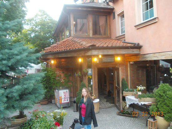 Olsztyn, Polonia: My friend, Agnieska, with the souvenir photo which I took.