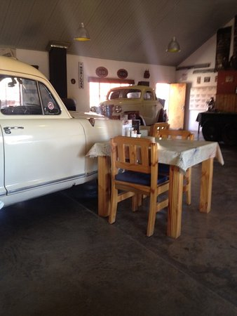 Fish River Canyon, Namibia: View of a table for 2 with classic cars.