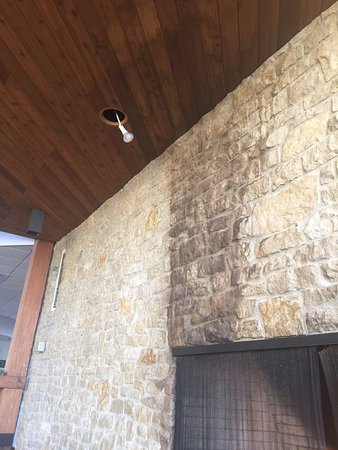 Mount Sterling, OH: Damaged fireplace with burned out bulb