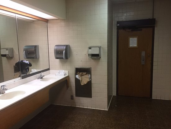 Mount Sterling, OH: 1980s bathroom with damaged hand dryer.