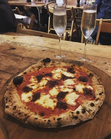 Altrincham, UK : Atomica pizza at Honest Crust