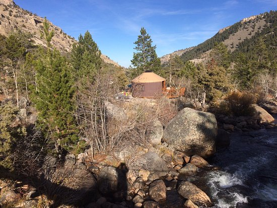 Lander, WY: View from the bridge crossing the Popo Agie River looking at one of the yurts.