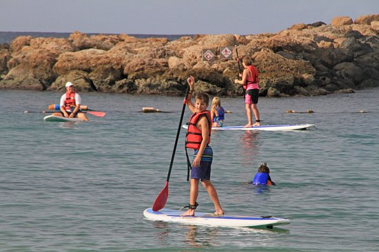Aulani, a Disney Resort & Spa: Paddle boarding in the Aulani lagoon with lifeguards always on duty