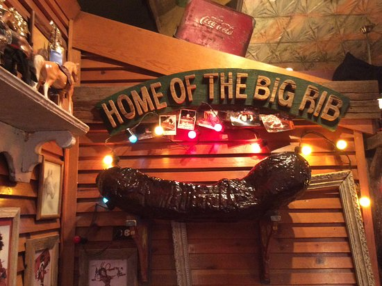 County Line : This giant plastic rib is what they take your picture with when celebrating a birthday!