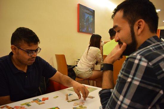 Meeples Cafe: us enjoying a free game