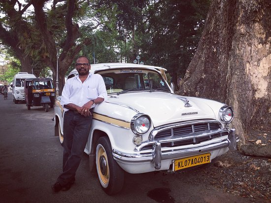 Old Harbour Hotel: Antony, our driver in his wonderful 1958 Ambassador available at the hotel.