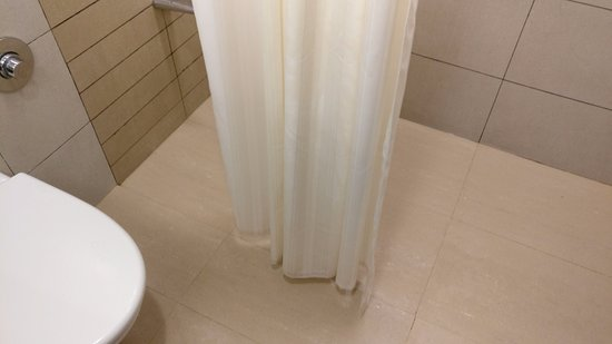 Hotel Suba International: No grab rail in the shower area. Curtains too small to prevent water from spilling all over
