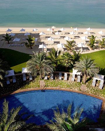 Shangri-La Hotel, Qaryat Al Beri, Abu Dhabi: Aerial view of swimming pool and beach