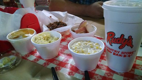 Rudy's: Creamed corn, potato salad, red potatoes, peach cobbler, and chopped BBQ.