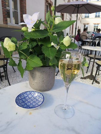 Champagne Collard-Picard: Glass of Champagne in the outside seating area