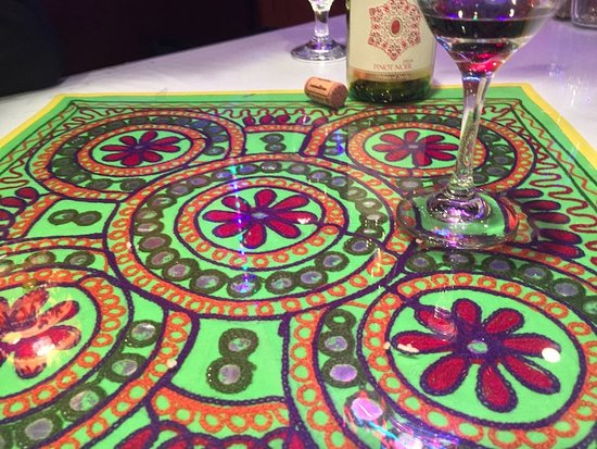 Winchester, Wirginia: The glass table tops have gorgeous Indian fabrics underneath them.