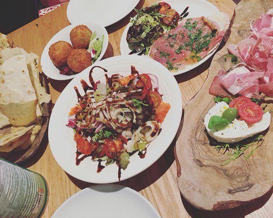Salumeria Cafe & Deli Shop: A selection from the menu to share .
