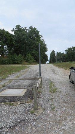 Quapaw, OK: lonely gravel road to plaque