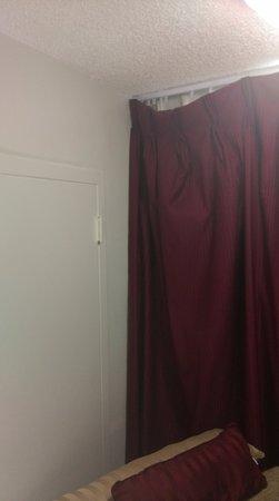 Super 8 Anaheim Near Disneyland: Curtain off hinge and falling, door was painted shut