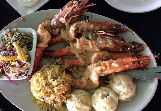 Britto's: Tiger prawns in butter garlic with mashed potato, rice and salad