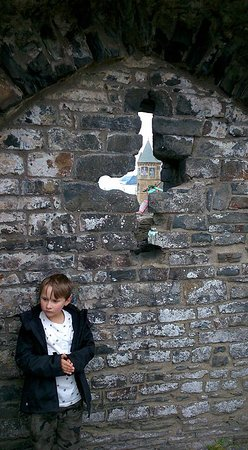 Aberystwyth, UK: son,castle wall,slide,college,headland then peninsular in distance