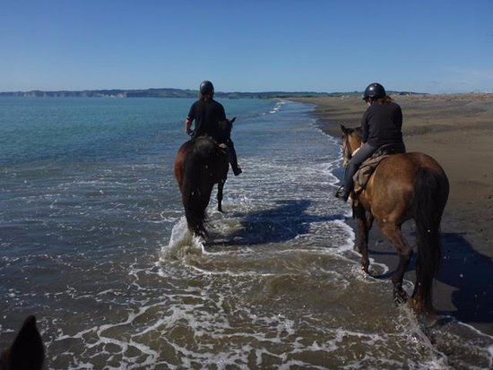 Us riding on Clive beach