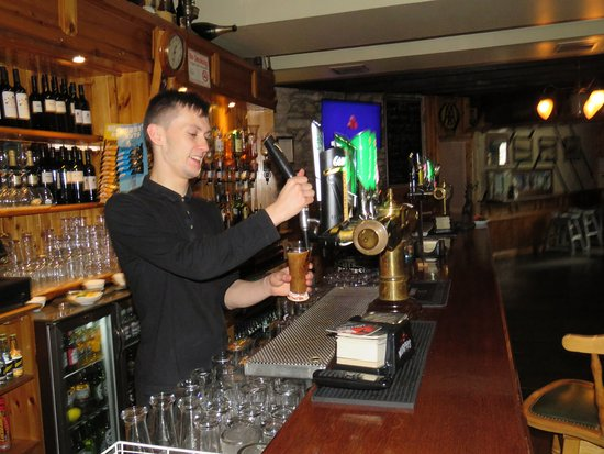 """The Bold Thady Quill: Our wonderful bartender """"pulling"""" a Guinness to perfection!"""