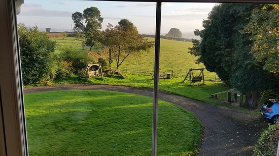 Cleobury Mortimer, UK: Red Room's cosy interior and the wonderful landscape on view from the bedroom window.