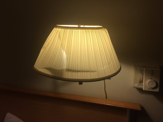Dover, VT: Crushed and broken lampshades over the bed. (Room 123)