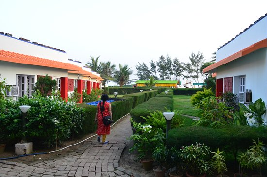 Neel Nirjaney: Way to beach through garden cottages