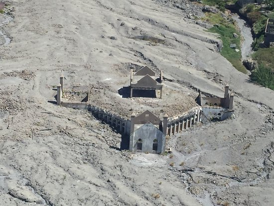 Caribbean Helicopters: church covered in ash from eruption on Montserrat