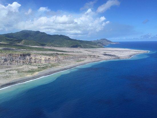 Caribbean Helicopters: coastline of Montserrat where ash flow went into ocean