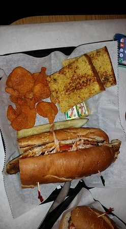 Satchmo's BBQ: Blackened catfish Po'Boy with homemade BBQ chips, and cornbread.