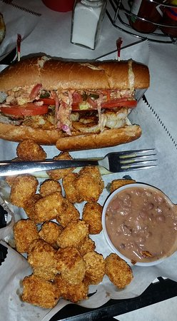 Satchmo's BBQ: Blackened shrimp Po'Boy with tots and red beans/rice