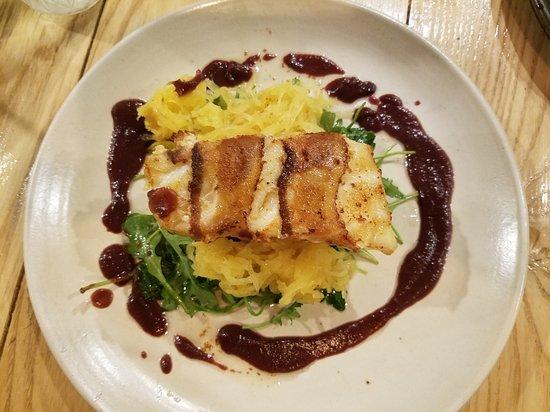 Shelton, CT: Bacon wrapped sea bass with spaghetti squash, sautéed arugula with a beet sauce