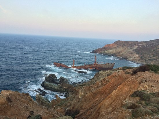 Andros, Greece: The wreck is hidden round the corner from Vori beach (right of it as you face beach)