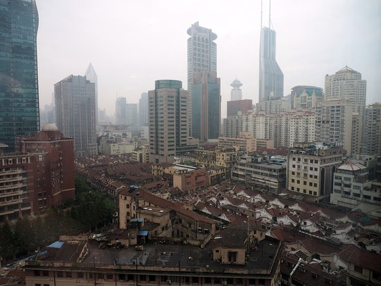 The Bund Hotel: View of older tenements and modern buildings typical Shanghai