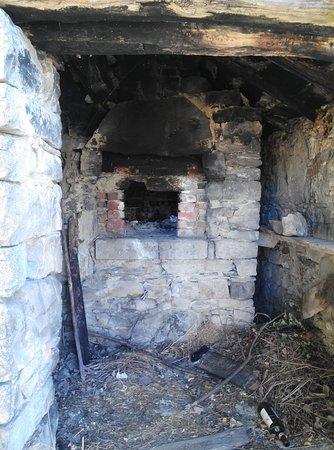 Emilia-Romagna, Italy: un particolare di un forno a legna nel borgo abbandonato di Chiapporato..