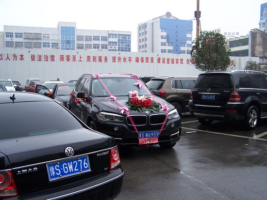 Huangchuan County, China: Ready for the wedding. Notice the expensive cars all over China