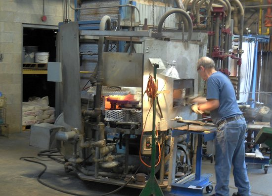 Cambridge, OH: Gas fired oven and craftsman in action.