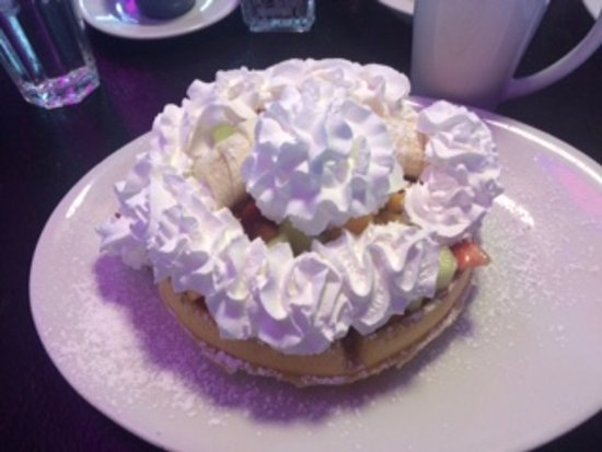 The Peppermill Restaurant & Fireside Lounge: Waffle with fruits and whipped cream