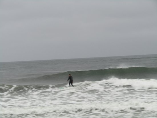 York, ME: A cold, rainy day surfer