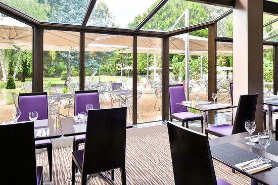 Ferney-Voltaire, فرنسا: Salle de restaurant