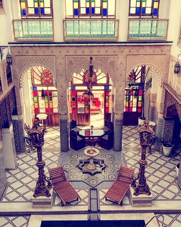 Riad Arabesque: Our roomview over the pool and a common area.