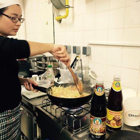 Thai food specialist preparing vegan OnThai rolls.