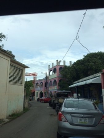Mamacitas Guest House: our room was the third floor of the pink building. note block and tackle for lifting materials