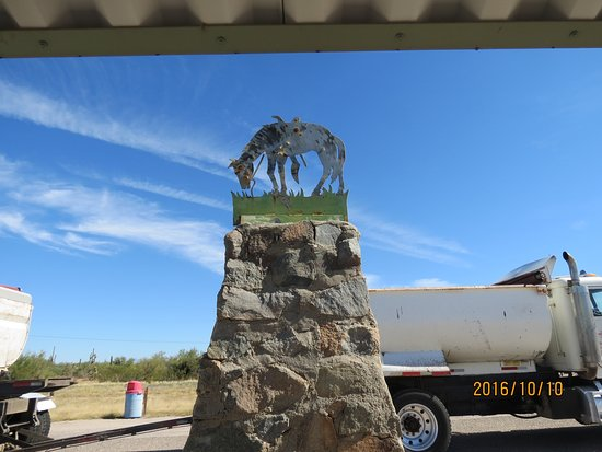 Florence, AZ: Stone marker with horse statue