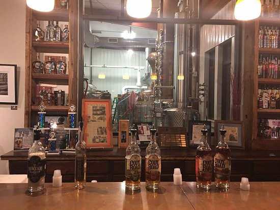 Le Claire, IA: Tasting room with view of distilling processes.