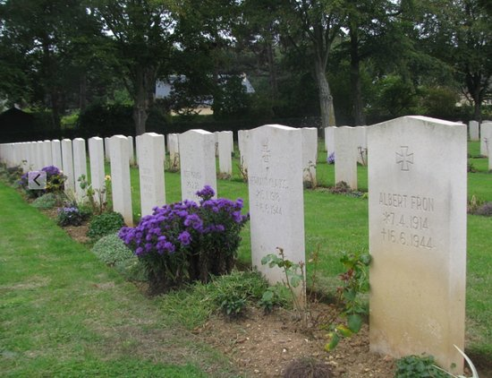 Ranville, France: The German section is just as well tended.