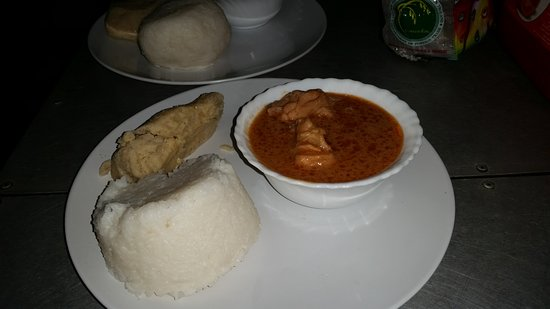 Accra Urban Adventures : The final dish - peanut soup with chicken (right), kenkey (lafet, back) and rice ball (left fron