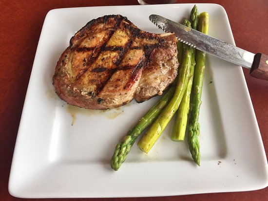 Gunslinger Duroc Bone-in 14oz Porkchop with Asparagus Side - Mater'z Steakhouse, Wauchula FL