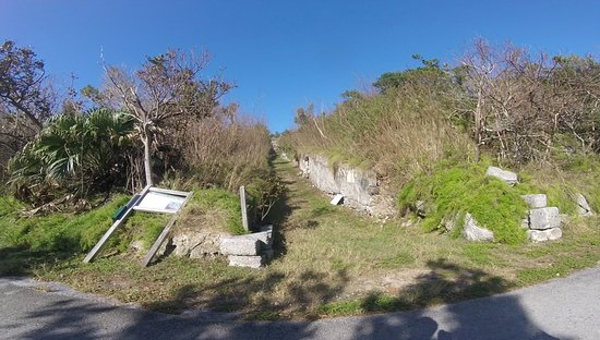 Hamilton, Bermuda: Fort Scaur sign blown over in storm days prior, path just out of frame left.