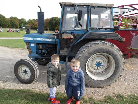 Woodchurch, UK: my boys with tractor , there mad about it