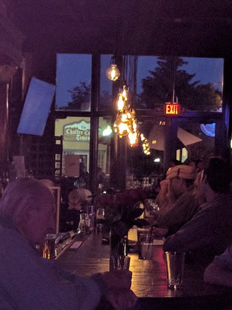 Bar at The Lariat - OLD beautiful bar where you can now watch big screen TVs