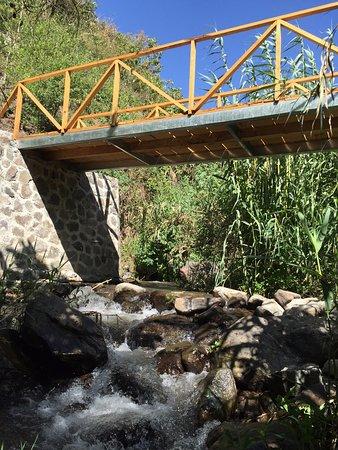 Mahadevi Ashram: bridge over river beside property